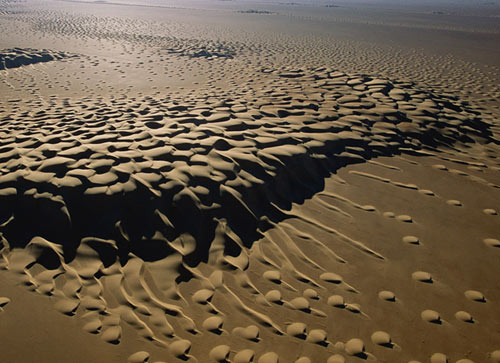 The Uncritical Solitonic Undulations of Barchan Sand Dunes ...